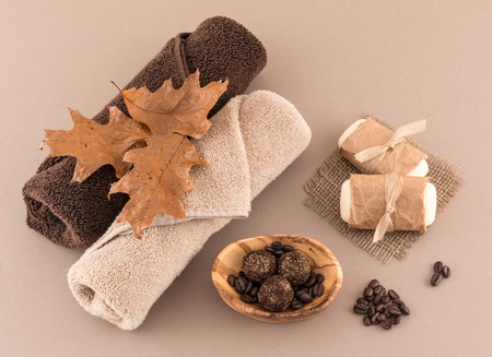 towels luxury: Autumn Spa with Coffee Bath Bombs Soap and Luxury Towels Stock Photo