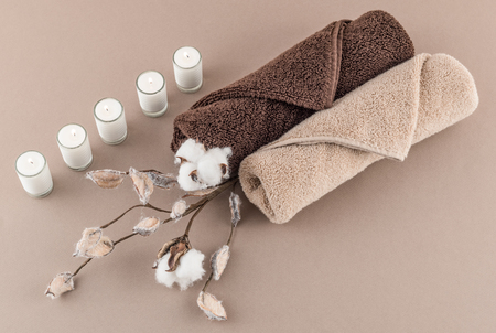 towel: Spa Luxury Towels Cotton Branch and Lit Candles Stock Photo
