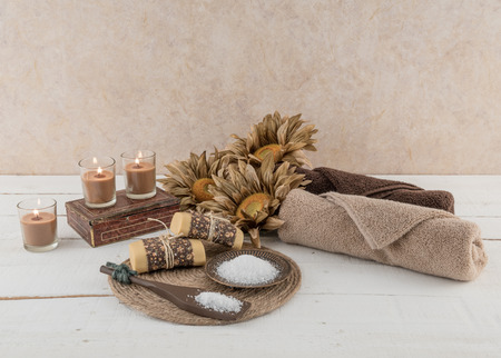 candlelit: Spa and Bath Essentials in Rustic Candlelit Scene Stock Photo