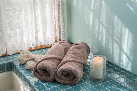 master: Luxury Towels and Candle in Master Bath Stock Photo