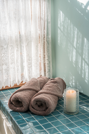 master bath: Master Bathroom Luxury Towels and Candle Stock Photo
