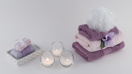 Luxury Bath Soap and Towels with Lit Candles