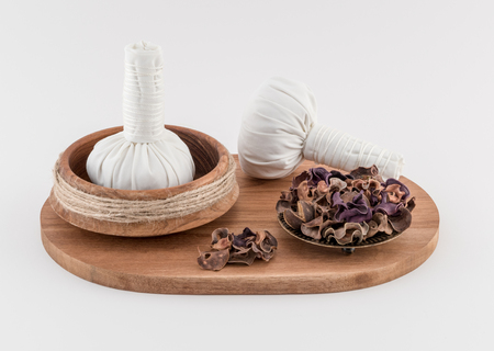 dried herbs: Spa Massage Balls with Dried Herbs on Wooden Tray