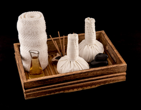 Thai Herbal Massage Balls with Massage Oil Towel and Incense Stock Photo