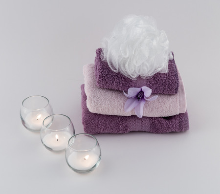 revitalize: Towels and Bath Pouf with Lit Candles