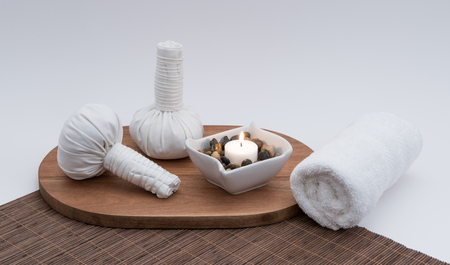 Herbal Massage Balls with Candle and Rolled Towel