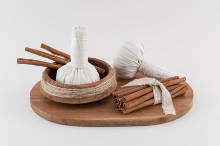 Thai Massage Balls and Cinnamon Sticks