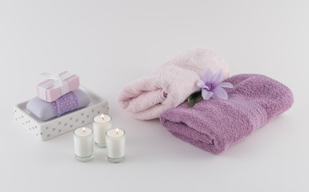 towels luxury: Luxury Bath Soap with Towels and Lit Candles