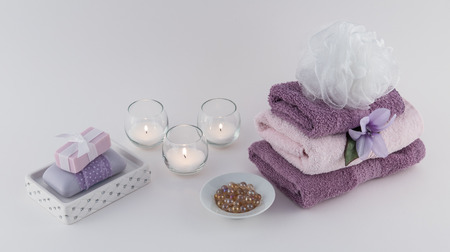 Bath Oil Beads and Luxury Bath Soap with Towels and Candles Reklamní fotografie