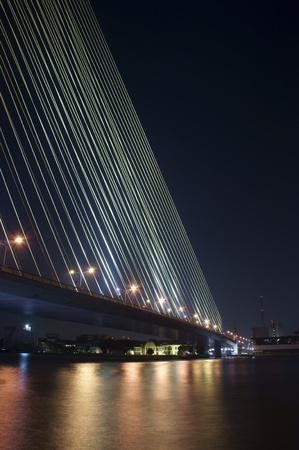 body scape: Night shot of modern bridge                    Stock Photo