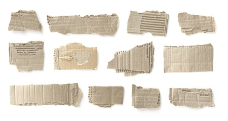 recycled paper: Pieces of torn brown corrugated cardboard, Isolated on White