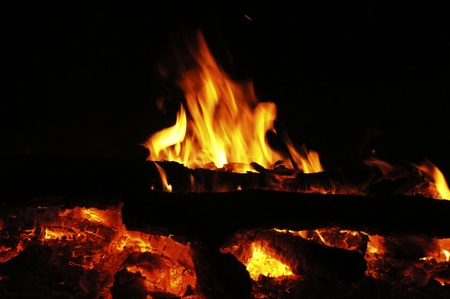 fireplace lighter: fire wood on dark background Stock Photo