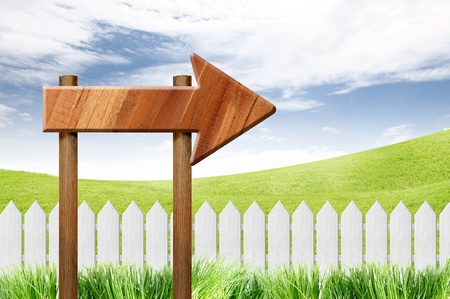 picket: wooden sign and White fence on clear blue sky