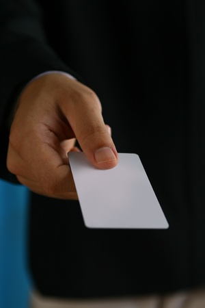 BUSINESSMAN holding an empty white business card  photo