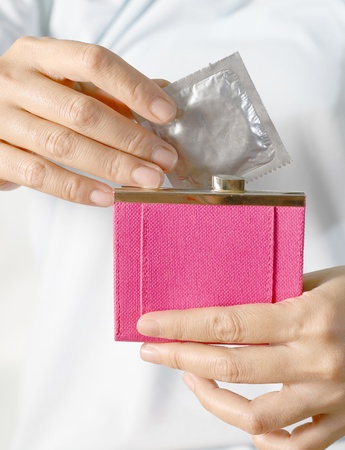 hand  woman and pink wallet  photo