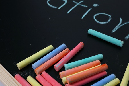 chalks: close up of blackboard and color chalks Stock Photo