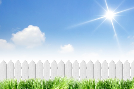 White fence with grass on clear blue sky Stock Photo - 10288804