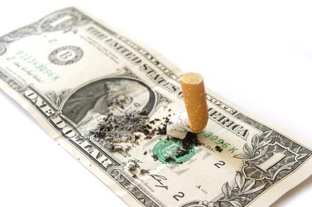 subsidy: Cigarettes money on white background