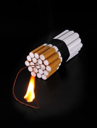anti smoking: Cigarette Bomb on dark background