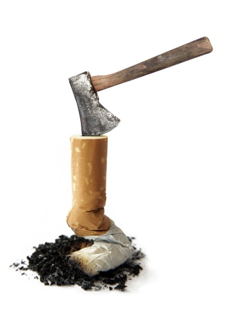 quit smoking: cigarette and Axe  isolated on white background