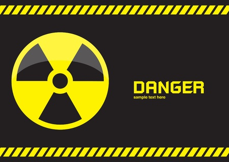 hazardous waste: nuclear symbols warning on dark background