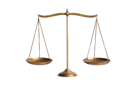 legal scales: golden brass scales of justice on white