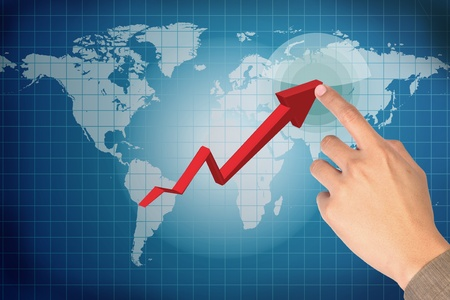 man finger pressing a red arrow on world-map Stock Photo - 10334030