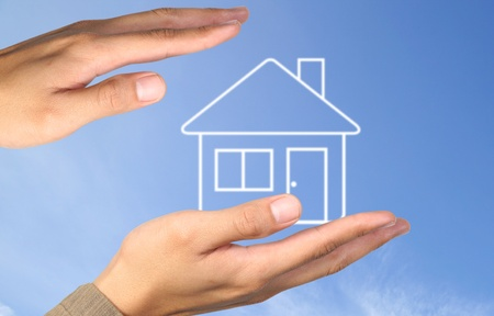 Hand house on blue sky Stock Photo - 10334024