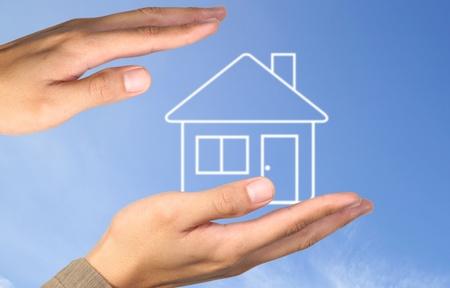 Hand house on blue sky Stock Photo - 10334024
