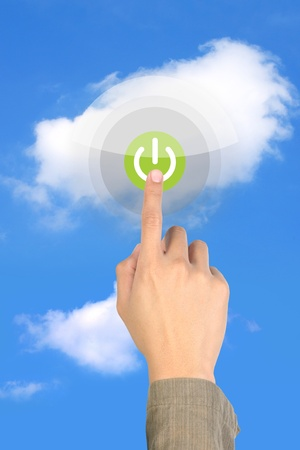 touching start on green button on cloud photo
