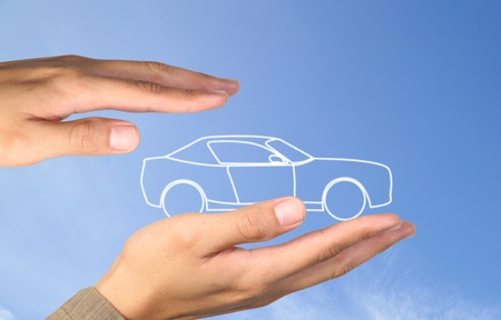 car in hands on blue sky photo