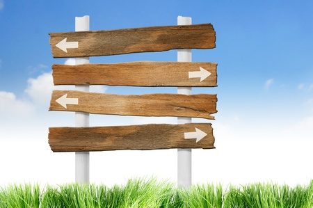 wooden signpost on blue sky  photo