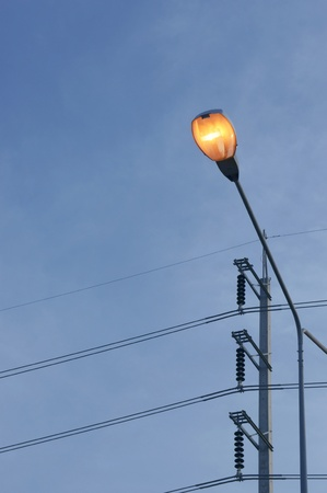 orange lighting electric pole photo