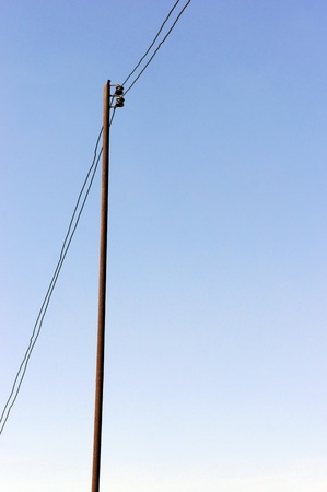 electric utility: Electricity supply post on blue sky background