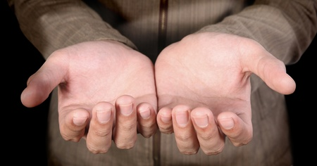 human hands  on a dark  background Stock Photo - 10378764