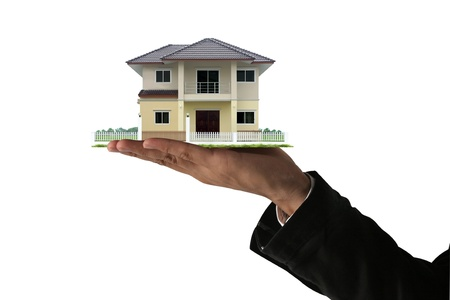architectural model: The House in the human hands. Stock Photo