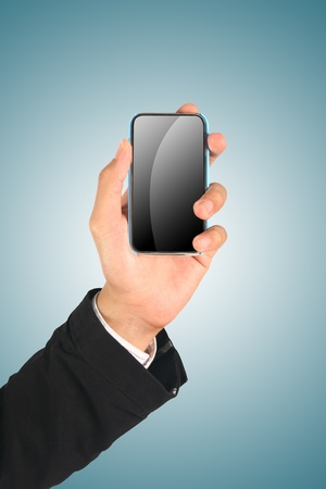 Business Hand holding smart phone on blue Stock Photo - 10710171