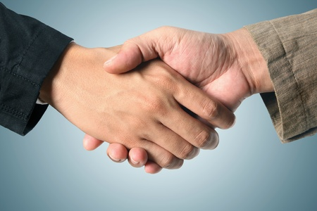 Closeup of business people shaking hands  photo