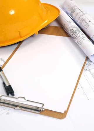 yellow hard hat and blueprints background Stock Photo - 10849809