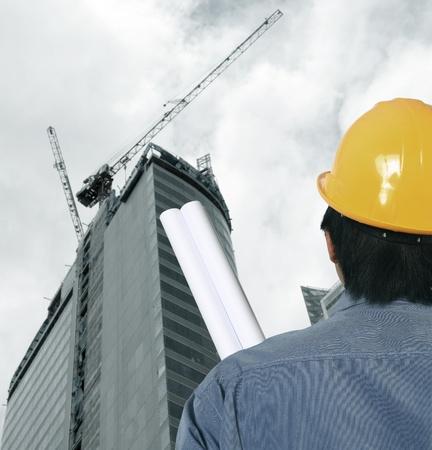 construction site helmet: Workman  and helmet at a construction site