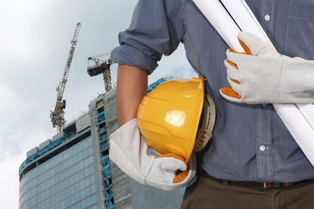 work safety: construction worker on suite