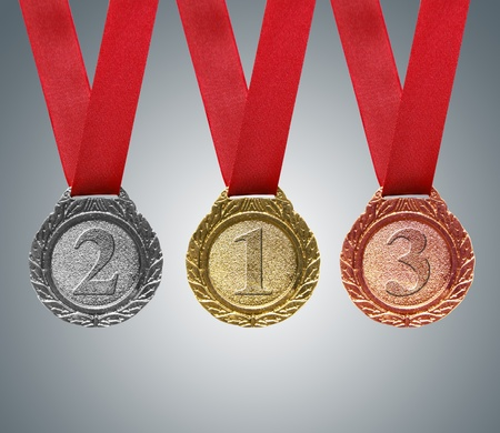 a collection of awards icon: Gold, silver and bronze medals with ribbons Stock Photo