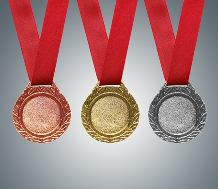 Gold, silver and bronze medals with ribbons photo
