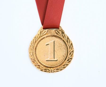 gold award ribbons on white photo