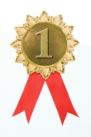 gold award ribbons on white photo