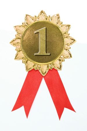 gold medal: gold award ribbons on white