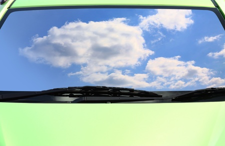 eco car: cloud and blue sky on  green eco cars  Stock Photo