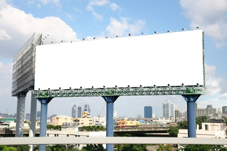 Blank billboard with cityscape on sky photo