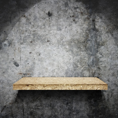 single shelf: grunge  wall and wooden shelf  Stock Photo