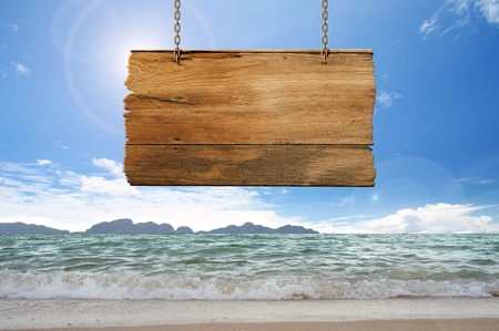 wood sign hanging on beach Stock Photo - 11540339